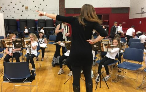 CONDUCTING BUSINESS -- Musicians and teachers from all five schools in Watertown, Mass., prepare for Bandarama 2019 in the Watertown High School gym on Tuesday, March 12.  Photo by Isabella Nitschke/Raoder Times (Watertown High)